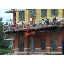 Mast climbing working platform