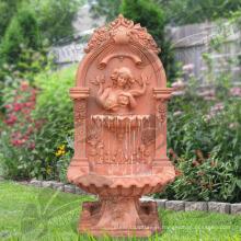 Fontaine murale en marbre tête de lion