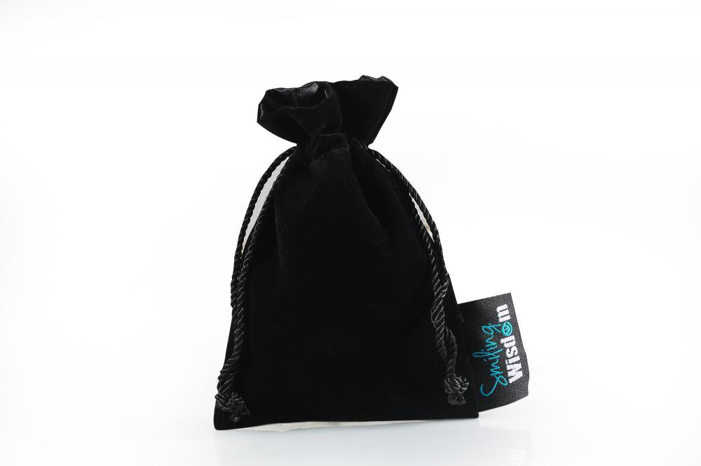 black velvet gifts bag with label