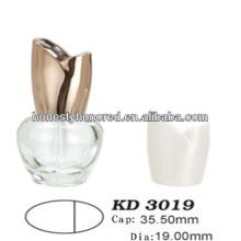 Ellipsoid Nail Polish Bottle And Golden Rose Cap