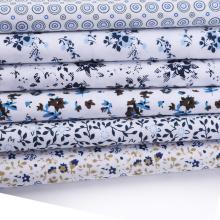 Tejidos estampados de popelina blanca con lunares para coser camisas