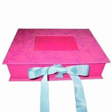 Paper folding box with ribbon closure and PVC window