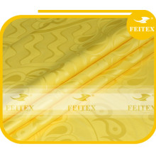 Nueva llegada de la ropa amarilla Shadda Guinea Brocade tela de algodón Bazin Riche textiles africanos para la fiesta de la boda FEITEX
