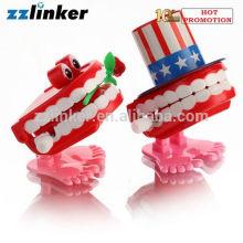 LK-S13 Dental Crafts Wind Up Spielzeug Springen Zähne mit Rose