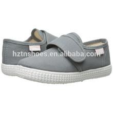 China-niedrige Preis-Großverkauf-Segeltuch-Schuh-Kind-Einspritzung-beiläufiger flacher Schuh