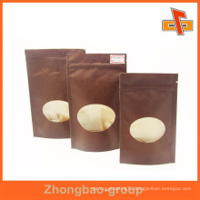 Customized size kraft nuts paper bag with oval window and zipper manufacturer