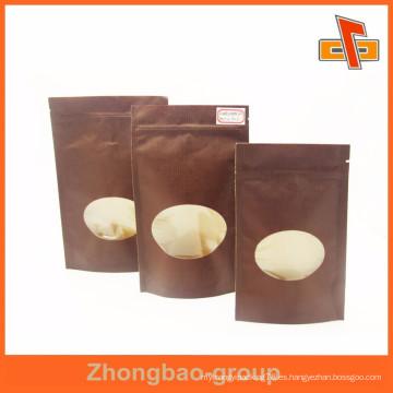 Tamaño personalizado kraft frutos secos bolsa de papel con ventana ovalada y cremallera fabricante
