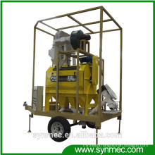 rotary seed cleaner with seed treating unit