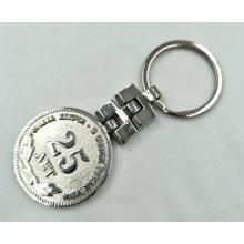 Porte-clés logo plaqué nickel brillant