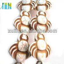 perlas sintéticas Howlite en forma de animal blanco turquesa al por mayor