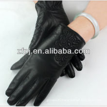 Ladies black mid-length hand gloves driving of a car