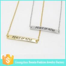 Collier de barre d'infini plaqué or avec logo estampé à la main personnalisé