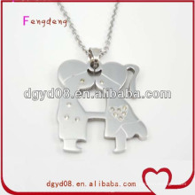 Stainless steel boy and girl couple necklace supplier