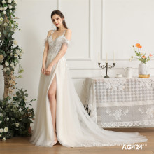 Professionally designed elegant ladies embroidered lace chinese sheer wedding dress with white train deep v neckline
