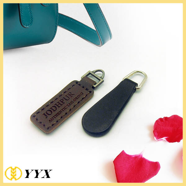 Genuine leather zipper puller with stamped logo