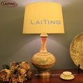 Modern ceramic table lamp with white shade with dragon plating