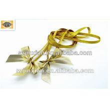 Arco elástico del regalo del embalaje del oro
