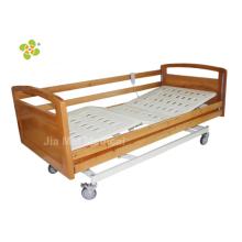 Cama de enfermería de madera con barandilla