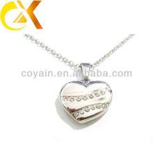 China alibaba Colgante de joyería de acero inoxidable, colgante de encargo de las mujeres hueco del rhinestone del corazón