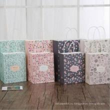 Подарочная сумка из крафт-бумаги с цветочным рисунком и ручками. Подарочные пакеты для фестиваля.