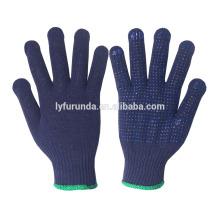 Blaue Baumwoll-Arbeitshandschuhe mit pvc-Punkten beschichtet auf Palme