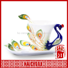 Ceramic beautiful coffee cup and saucer with peacock design