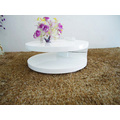 Table basse petit blanc rotatif brillant