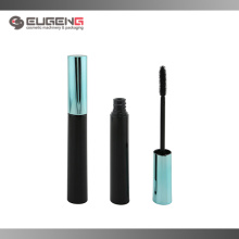 Flat round empty plastic mascara bottle