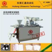 Machine de fabrication de serviettes chaudes pour bébé automatique
