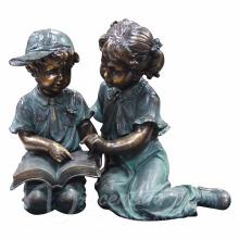 Escultura de jardín de metal tamaño grande tamaño de la vida leyendo estatuas de jardín de niño y niña en venta