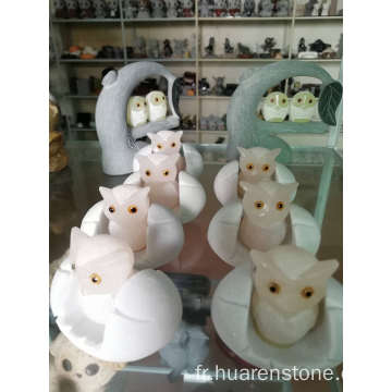 Sculpture hibou rose en onyx