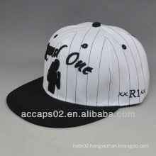 snapback with flat leather brim