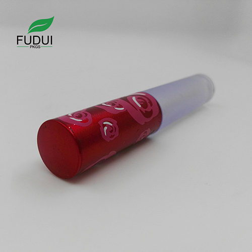 red lipgloss tube cosmetic