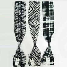 La última versión de los accesorios de la bufanda del lazo de las mujeres
