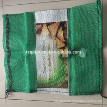 Netztasche für Brennholz, Fotos, Zwiebeln, Gemüse