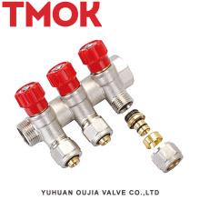 brass color three-way water manifold