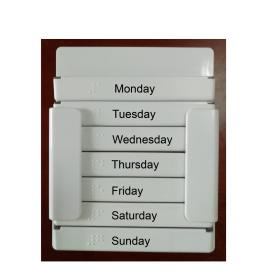 Braille weekly pill box with cutter