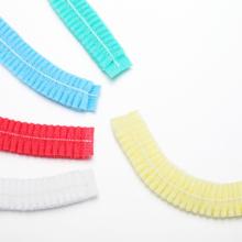 Disposable nonwoven bouffant clip cap