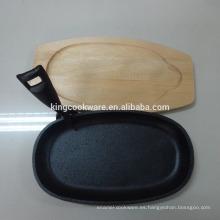 Sartén / placa sizzling antiadherente / pre sazonada de pizza de hierro fundido con base de madera