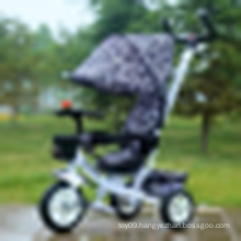 Three wheel differential motorised cheap baby tricycle with push bar for kids