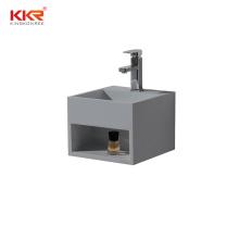 Light grey solid surface wall hung wash basin