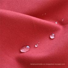 Tela impermeable de algodón resistente al fuego para prendas de trabajo.