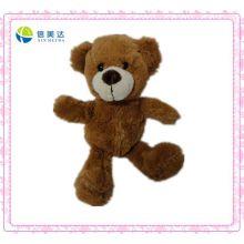 Plüsch Niedlicher Teddybär mit Bohnen auf dem Boden