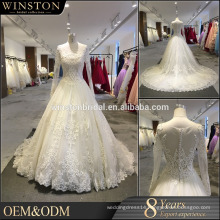 New Fashionable Special Design Neckline Long Sleeve Sash See Through Back Beaded Lace Appliqued Wedding Dress