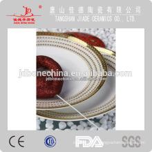 Las nuevas ventas calientes duraderos pintados a mano en relieve de oro nuevos utensilios de cocina de hueso china hechos en china
