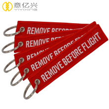 Personalized remove before flight tags embroidered keychain