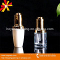 transparent and white glass hand pressure dropper bottle