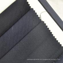 tela de lana dorada con estampado pequeño y azul marino para traje