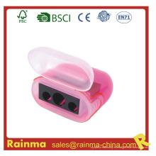 Afilador de lápiz de color rosa de tres agujeros