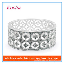 Expensive fine jewelry wide silver jamiaca bangle micro pave crystal